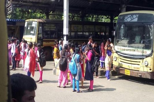 College students wait for a bus at the T Nagar bus depot in Chennai. (Photo: CNN-News18)