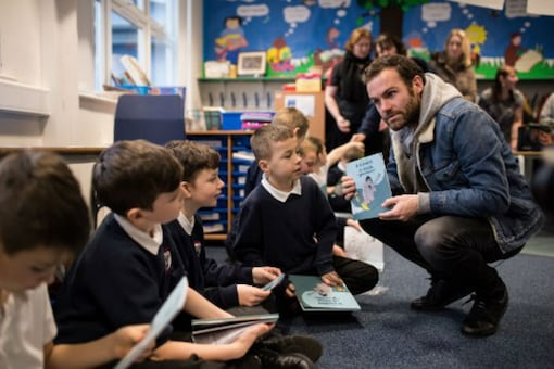 Manchester United's Spanish midfield player Juan Mata takes part in a Spanish class with pupils during a visit to Royton Hall Primary School through the Manchester United Foundation in Oldham, England on February 19, 2018. Juan Mata is a little bit different to the general impression of spoilt rich footballers, for the World Cup and Champions League winner has become the social conscience of the world's premier sport. It is reflected in the engaging 28-year-old Spanish forward's ambition to make his Common Goal project -- launched last year with German Juergen Griesbeck the founder of streetfootballworld -- 'the biggest football club in the world' as he told AFP.  (Image: AFP)