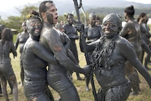 Revelers Getting Down and Dirty at Brazil's Mud Party