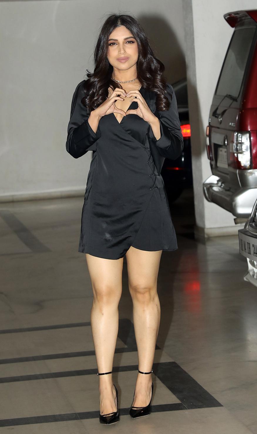 Bhumi Pednekar gestures as she arrives for 'Singles Only' party hosted by filmmaker Karan Johar at his residence in Mumbai on February 14, 2018. (Image: Yogen Shah)