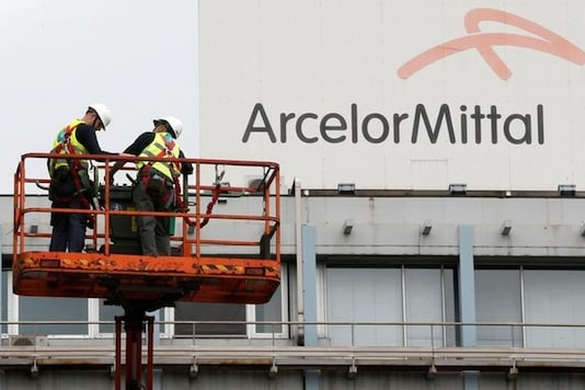 File photo of workers  near the logo of ArcelorMittal, the world's largest producer of steel, at the steel plant in Ghent, Belgium. (Photo: Reuters)