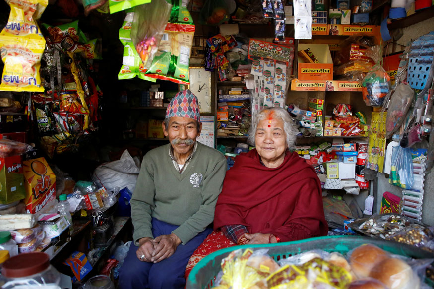 Nhuchhe Bahadur Amatya, 76, a retired accountant at Nepal Electricity Authority along with his wife Raywoti Devi Amatya, 74, a housewife, pose for a picture inside their shop in Lalitpur, Nepal. Nhuchhe was 17 and Raywoti was 15 when they had their arranged marriage 59 years ago.