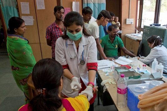 A doctor administers an injection to a woman at a hospital. (PTI Photo)