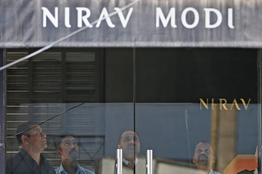 In this file photo, security guards stand inside a Nirav Modi showroom during a raid in New Delhi. (Reuters)