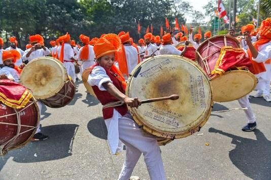 Marathi community members play drums as they celebrate Shivaji Jayanti in New Delhi. (Image: PTI)