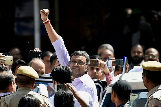 File - Karti Chidambaram being produced by CBI in the INX Media case, at Patiala House Court in New Delhi. (Image: PTI)