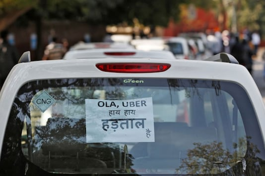 A note is pasted on a rear window of a car during a protest by Uber and Ola drivers, in New Delhi. (Photo: Reuters)