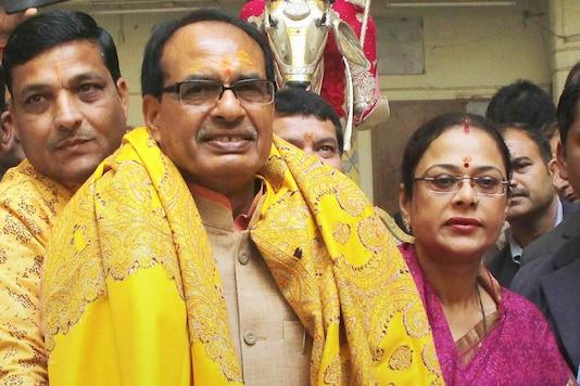 File photo of Shivraj Singh Chouhan and his wife Sadhna Singh. (Image: PTI)