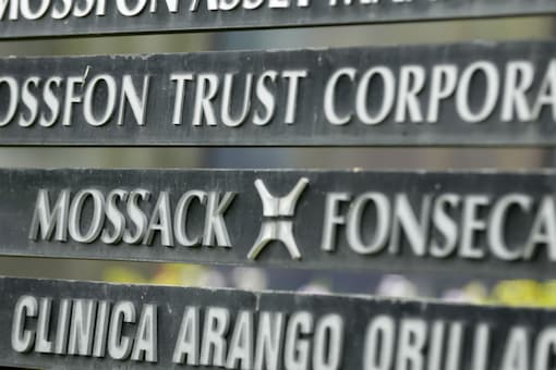 In this April 4, 2016 file photo, a marquee of the Arango Orillac Building lists the Mossack-Fonseca law firm, in Panama City. The firm announced on Wednesday that it will cease operations by the end of the month. (AP Photo/Arnulfo Franco)