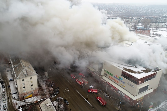 Smoke rises above a multi-story shopping center in the Siberian city of Kemerovo, about 3,000 kilometers east of Moscow, Russia. (Russian Ministry for Emergency Situations photo via AP)