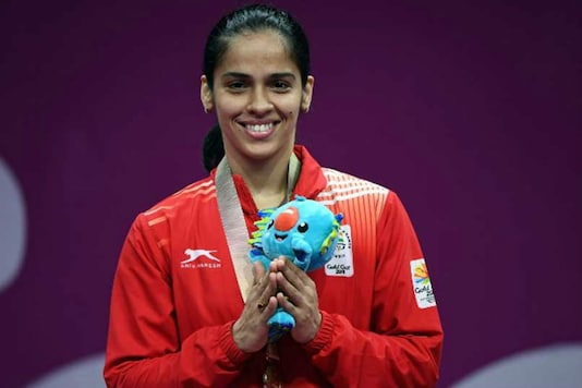 Saina Nehwal with her gold medal. (Image: Twitter)