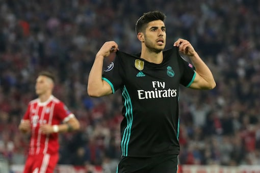 Real Madrid's Marco Asensio celebrates his winner against Bayern Munich (Image: Champions League/Twitter)