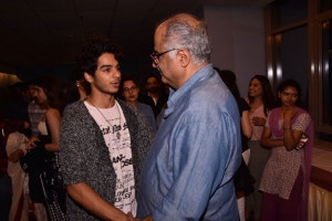 Ishaan Khatter chats with Boney Kapoor during the special screening of 'Beyond the Clouds' in Mumbai. (Image: Viral Bhayani)