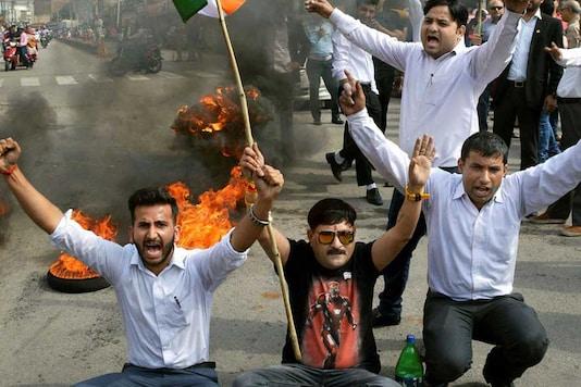 Members of Jammu Bar Association burn tyres during a strike on April 11. (Image: PTI)