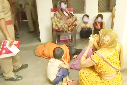 The woman (in orange) and her family at the police station on Sunday. (TV grab)