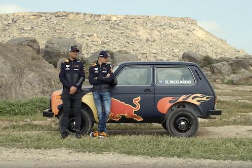 Ricciardo and Verstappen with Lada 4x4. (Image: Aston Martin Red Bull Racing)