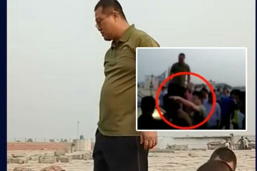 Chinese national seen standing atop a car bonnet and arguing with Pak security officials. (Courtesy: Dawn News)