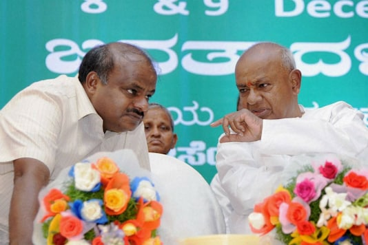 File photo of CM HD Kumaraswamy (left) with his father and JD(S) chief Deve Gowda. (PTI)