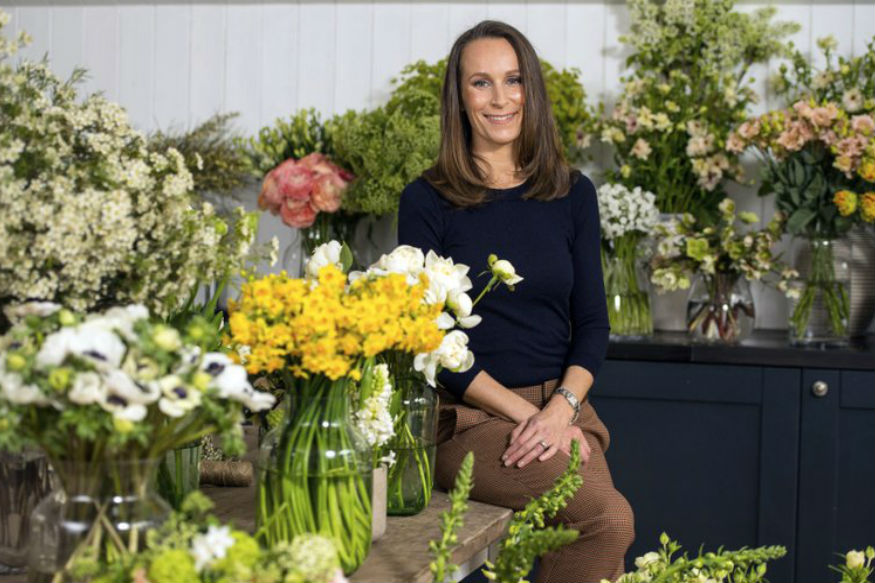 (Florist Philippa Craddock, poses for a photo, in her studio, in London. Philippa will create the church flower arrangements for the May 19 wedding at St. George's Chapel in Windsor. (Dominic Lipinski/Pool Photo via AP)