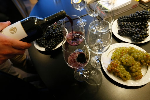 Bargylus wine is poured into a glass during a tasting session (Reuters)