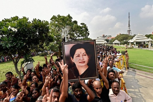Supporters with portrait of J Jayalalithaa (File photo)