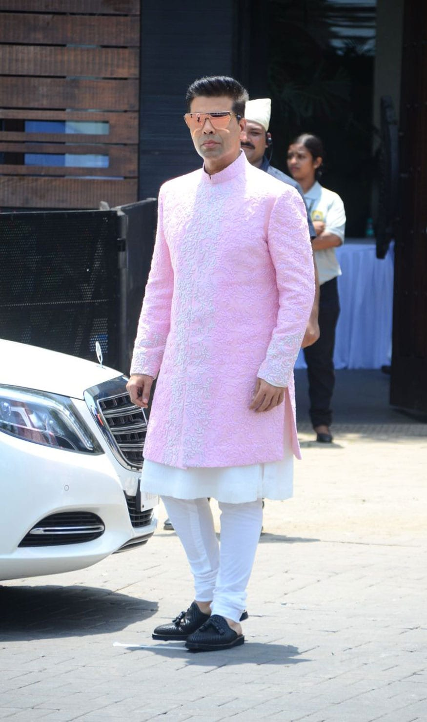 Karan Johar poses for photographers on his arrival at Sonam Kapoor and Anand Ahuja's wedding in Mumbai. (Image: Viral Bhayani)