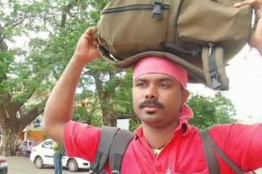 Sreenath K, a coolie by profession, cleared the Kerala Publice Service Commission by preparing online, using free railway internet services. (Image: ANI)
