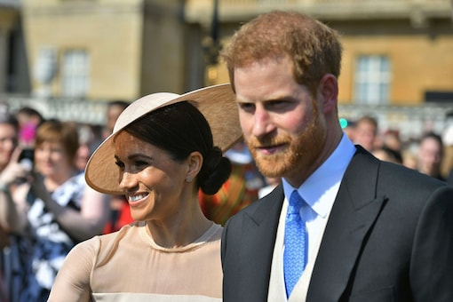 File photo: Meghan, the Duchess of Sussex walks with her husband, Prince Harry as they attend a garden party at Buckingham Palace in London. (Image: AP)