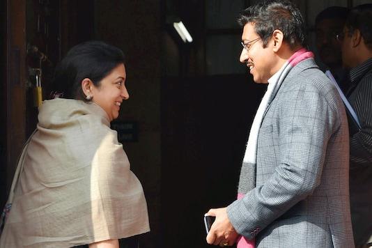 Smriti Irani has a word with MoS Rajyavardhan Singh Rathore at the Parliament. (File photo: PTI)