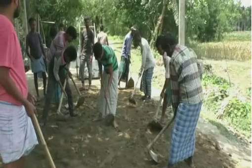 Villagers in Darrang district of Assam seen building a road.