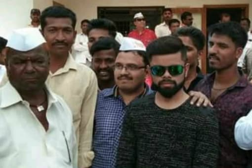 Sarpanch hopeful in Maharashtra Vitthal Ganpat Ghavate brought a lookalike of Virat Kohli to the rally instead of the real deal. (Photo tweeted by @TheChaoticNinja)