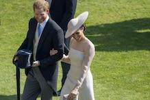 Newlyweds Harry and Meghan Markle Make First Appearance