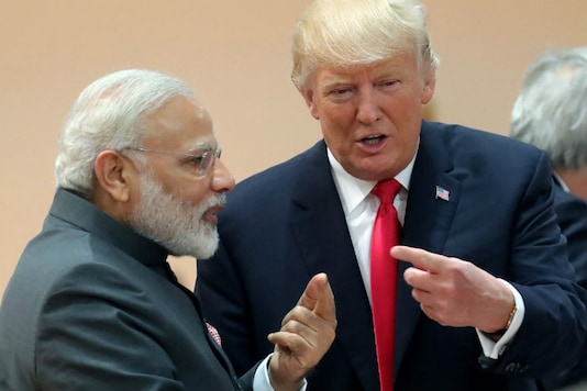 File photos of Prime Minister Narendra Modi with US President Donald Trump.