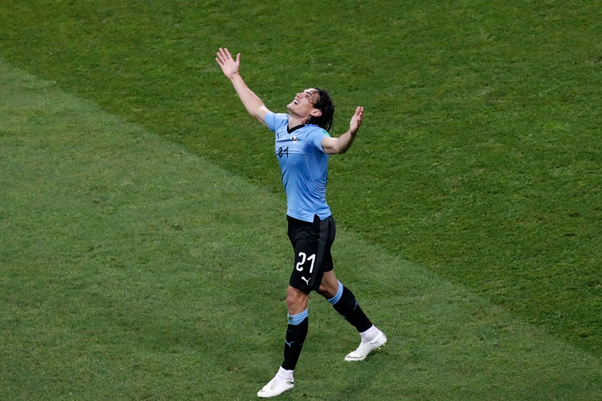 Edinson Cavani celebrates after scoring for Uruguay. (AP Photo/Darko Vojinovic)