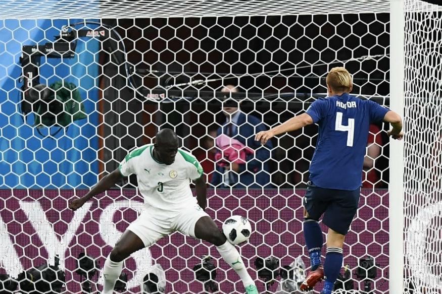 Japan's Keisuke Honda scores against Senegal (Image: FIFA)