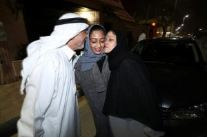 Hannan Iskandar is kissed by her parents, after she drove her car in her neighborhood, in Al Khobar
