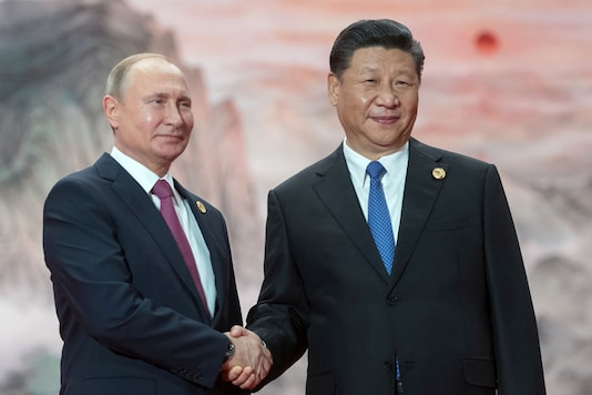 File photo of Russian President Vladimir Putin and President of the People's Republic of China Xi Jinping. (Image: Reuters)