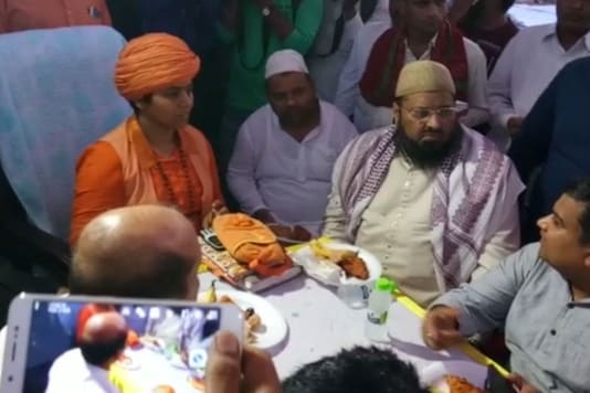 Mahant Devyagiri, the first woman chief priest of the temple hosting iftar for 500 muslims in the temple.