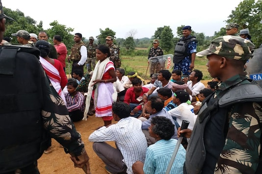 Policemen and tribals were locked in a stand-off in Jharkhand's Ghagra village after the rapes. (Photo: News18)