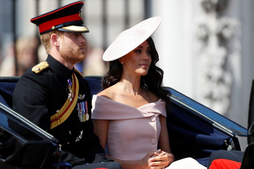 Here's why Meghan Markle has to stand behind the other royals