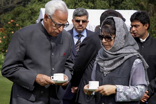 In this file photo, Governor NN Vohra speaks with former CM of Kashmir Mehbooba Mufti. (PTI Photo)