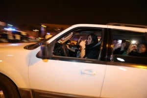A Saudi woman celebrates with her friends as she drives her car in Al Khobar