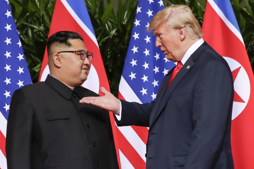Body Language Experts Decipher Trump and Kim's First 60 Seconds Together