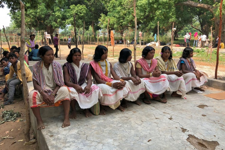Members of the Dongria Kondh tribe attend a protest demanding the ouster of a Vedanta Limited alumina plant in Lanjigarh