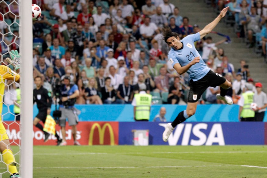 Uruguay's Edinson Cavani scores his side's opening goal. (AP Photo/Andrew Medichini)