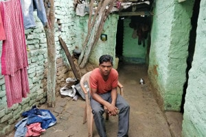 Arun-Kumar,-son-of-rickshaw-puller-Baijnath-Ravidas-in-Dhanbad.-He-remembers-his-hungry-father-waiting-for-food-till-his-last-breath