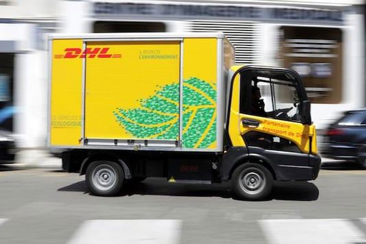 A DHL delivery van drives along a street in Nice, France. (Image: Reuters)