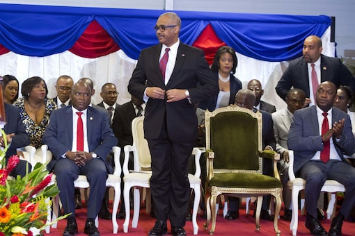 Haiti's Prime Minister Dr. Jack Guy Lafontant stands on stage during his confirmation ceremony at the National Palace, in Port-au-Prince, Haiti. Lafontant resigned on Saturday. (Image: AP)