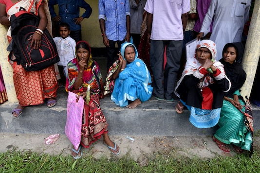Villagers wait outside the National Register of Citizens (NRC) centre to get their documents verified by government officials at Mayong Village in Morigaon district in Assam (File photo)
