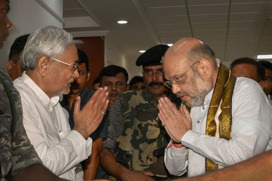 Bihar chief minister Nitish Kumar (left) and BJP chief Amit Shah greet each other in Patna. (PTI File photo)